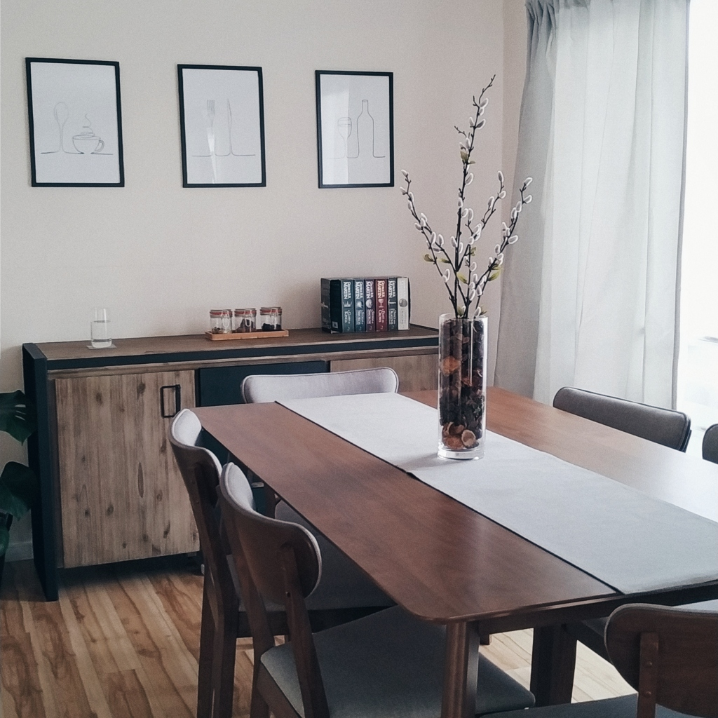 Dining area with wood furniture, a centerpiece, and 3 minimal wall art