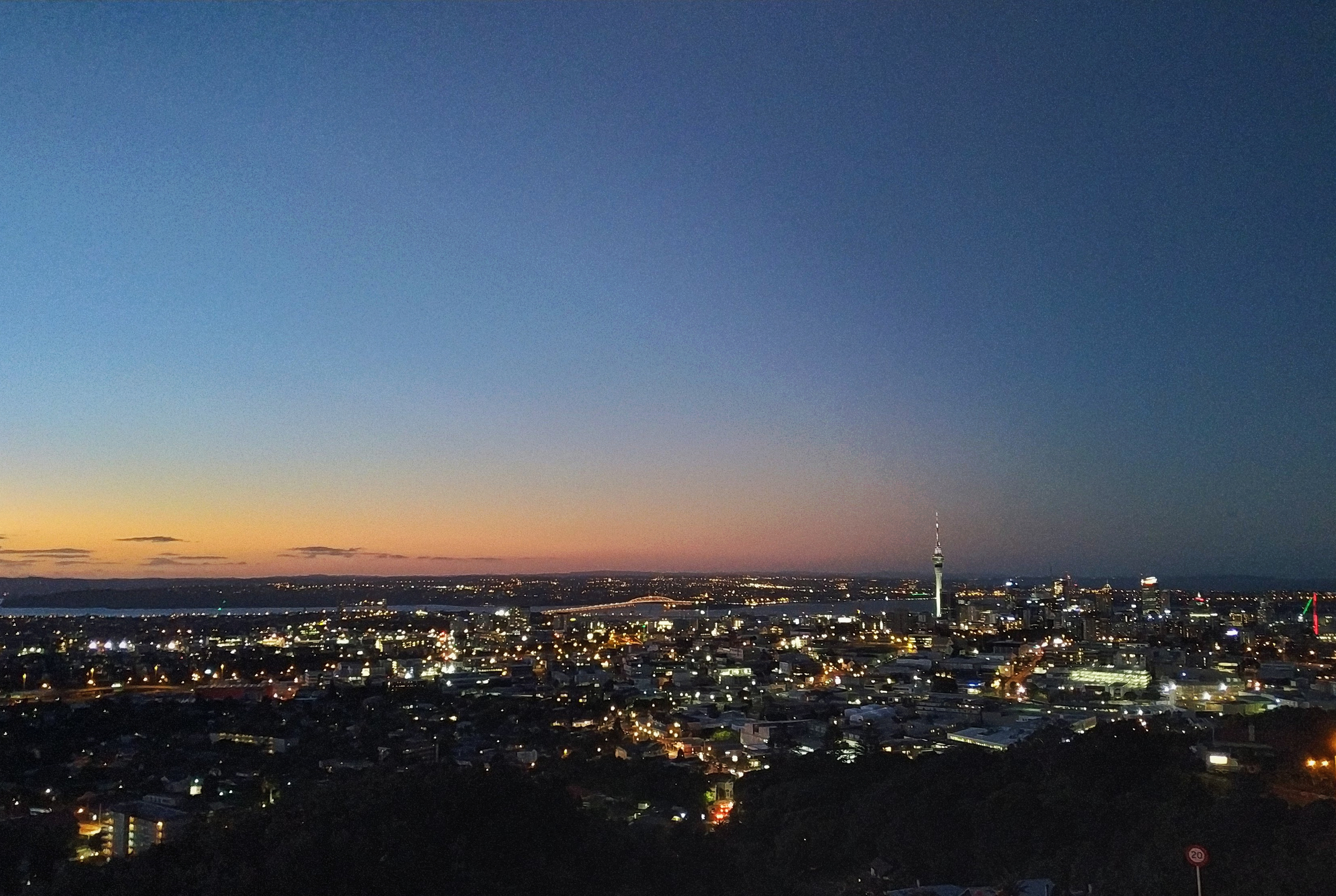 Overlooking Auckland, New Zealand from Mt. Eden during sunset