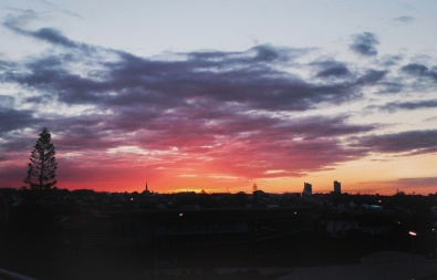 Colorful sunset with a silhouette of the city