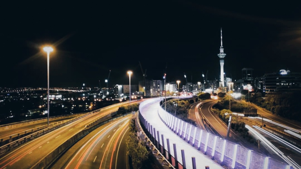 Auckland cityscape, the Sky Tower, and the pink lightpath
