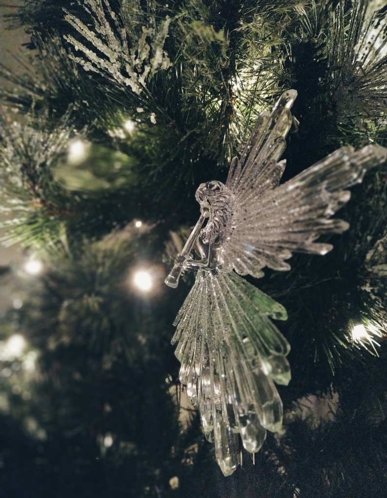 Acrylic angel ornament in a Christmas tree