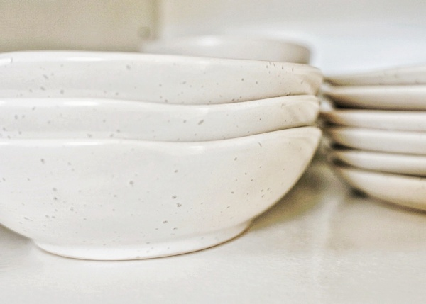 Stack of speckled bowls and plates
